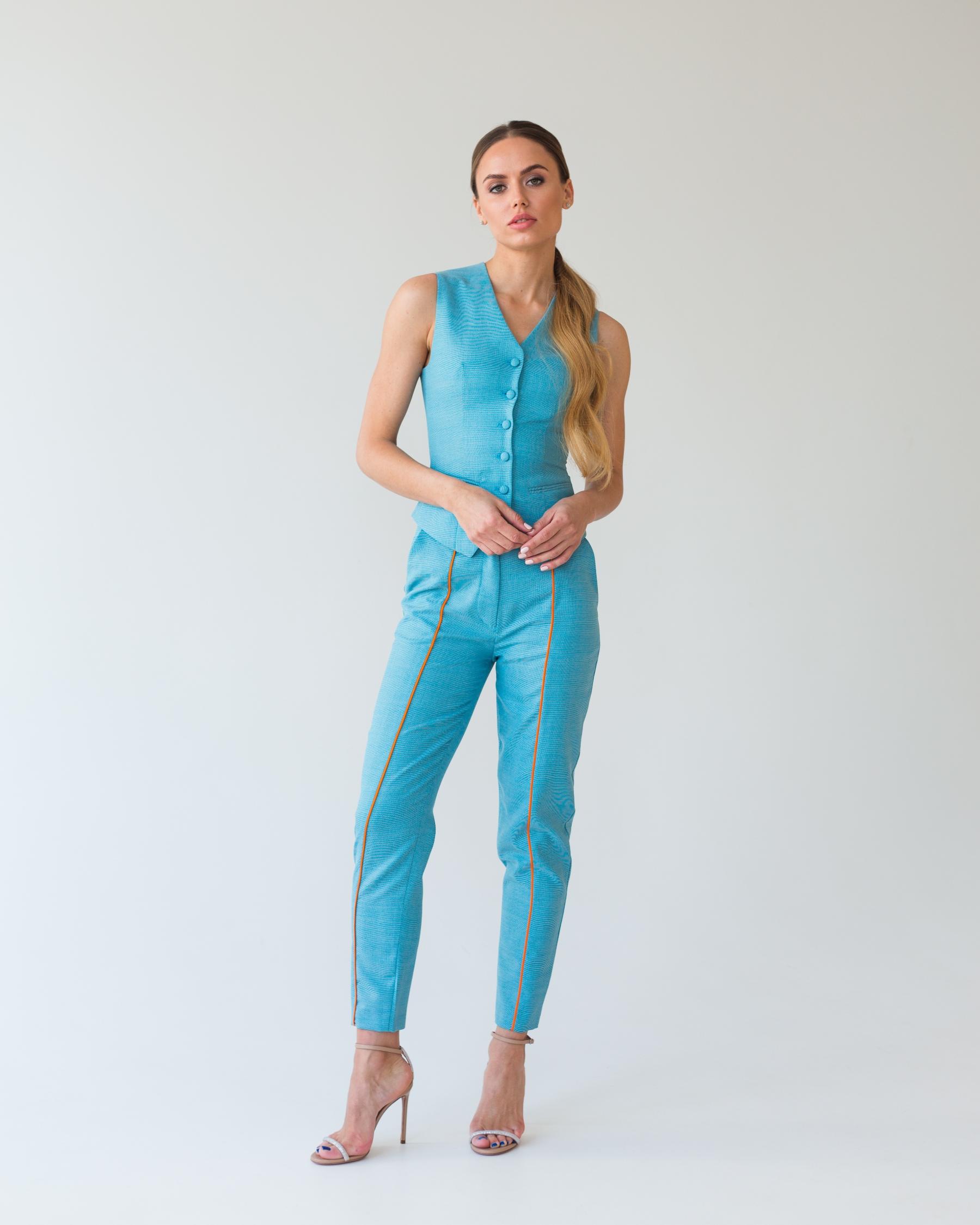 Бирюзовые брюки из тонкой костюмной шерсти с оранжевым кантом