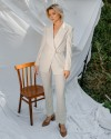 Молочные брюки из тонкой костюмной шерсти с молнией